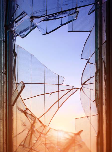 Broken window glass fragments detail stock photo
