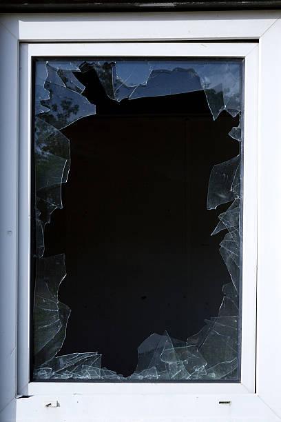 broken window glass stock photo