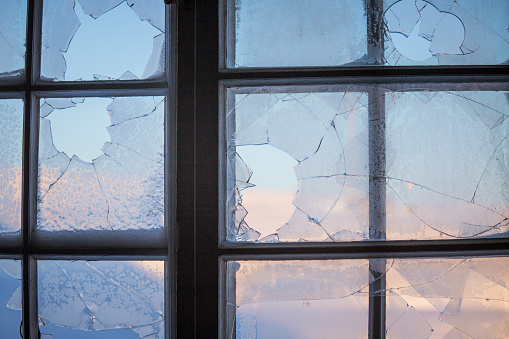 Broken Window Glass With A Winter Scenery Outside Stock Photo - Download Image Now