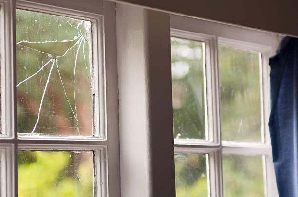 Broken window in an old home stock photo
