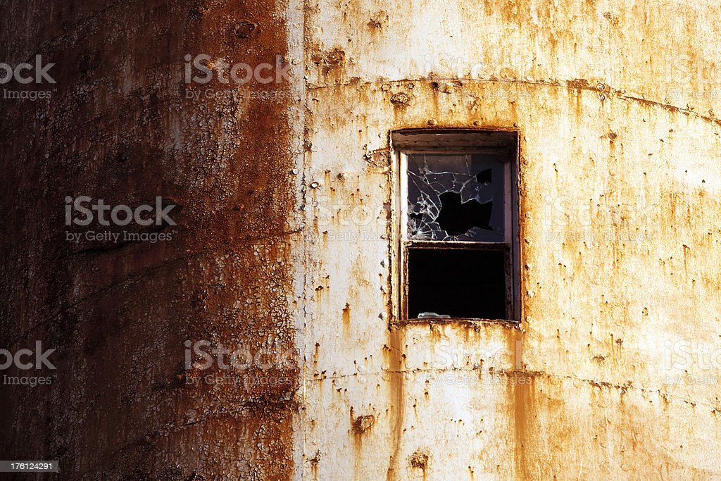 Broken window in rusted wall royalty-free stock photo