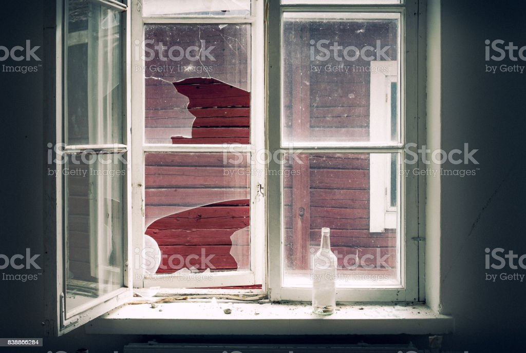 Broken window in the abandoned house stock photo