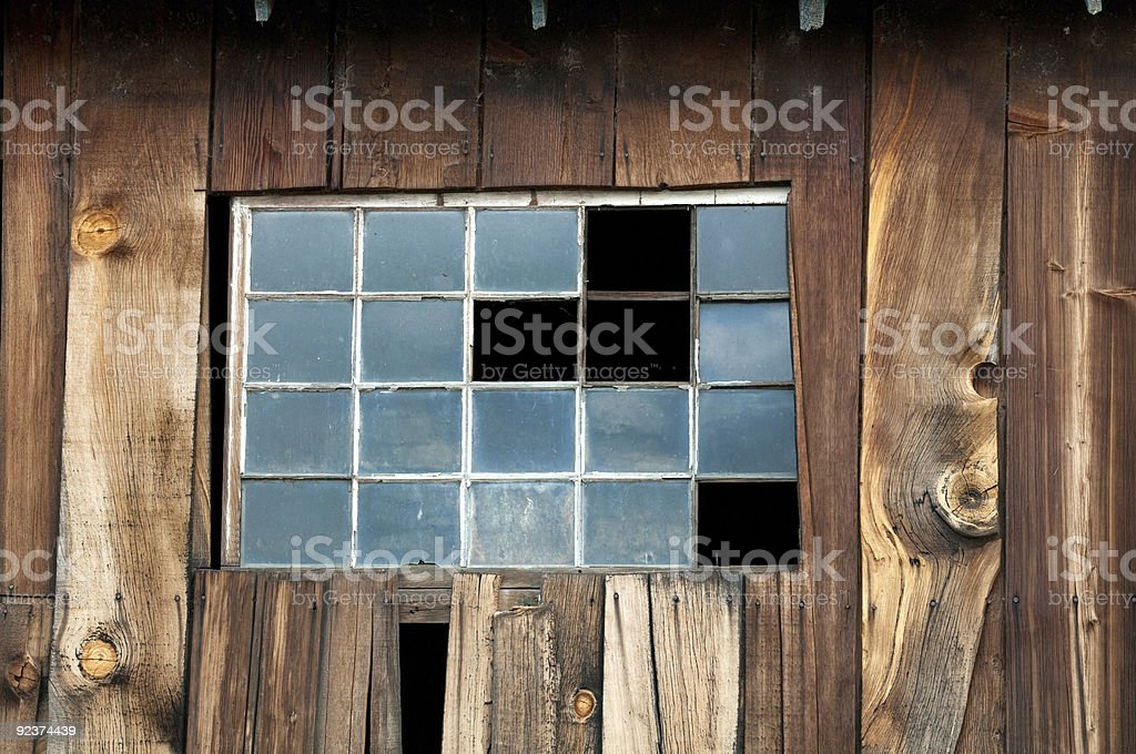 Broken Window Panes in Barn Wall royalty-free stock photo