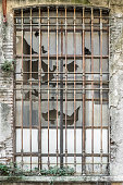 Old factory windows. Industrial photo. Amazing glass window texture. Abandoned building with beautiful old italian industry architecture.
