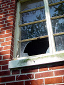 Window patched with red brick and door