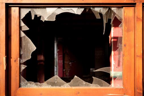 close up shot of broken glass of window frame