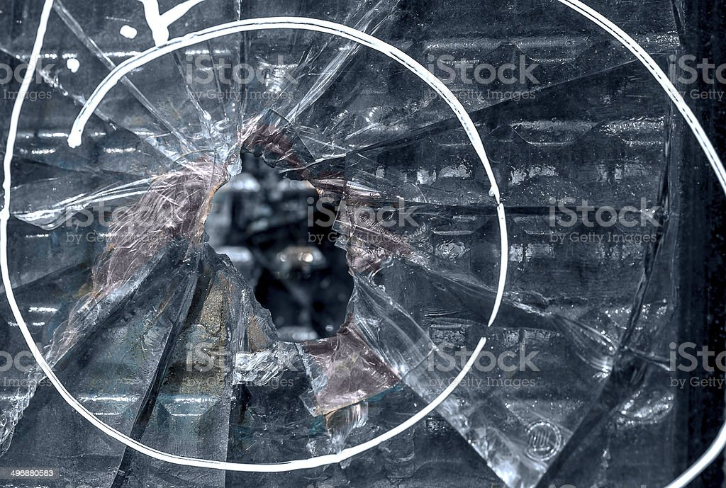 Broken window with a bullet hole in the middle royalty-free stock photo