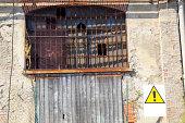 istock Broken window with warning sign 172976462