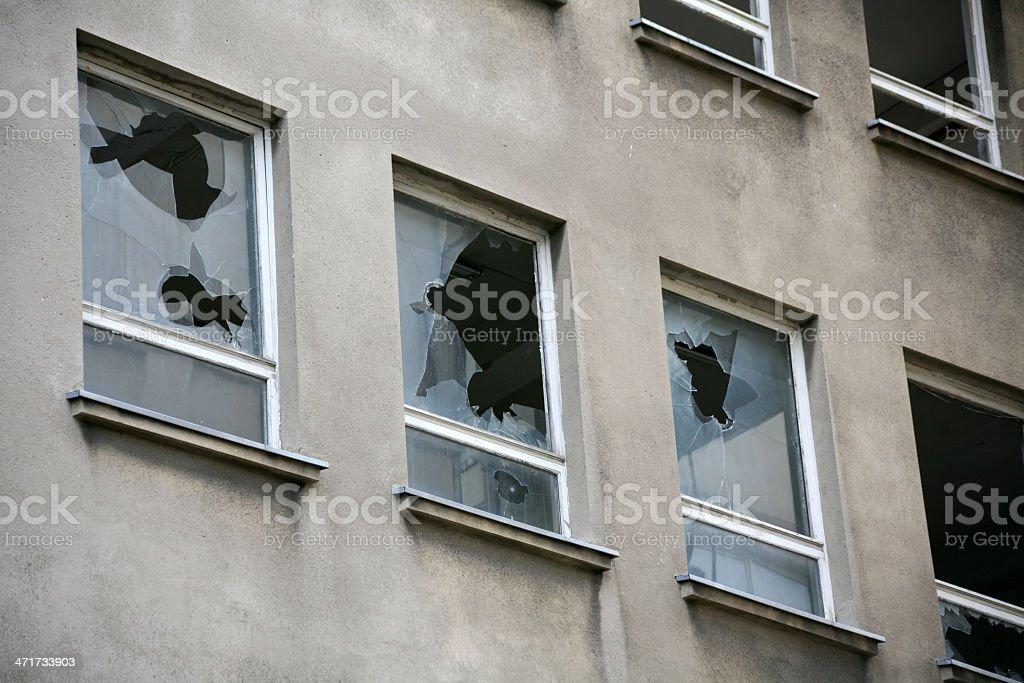 Broken windows in a vacant block of flats stock photo