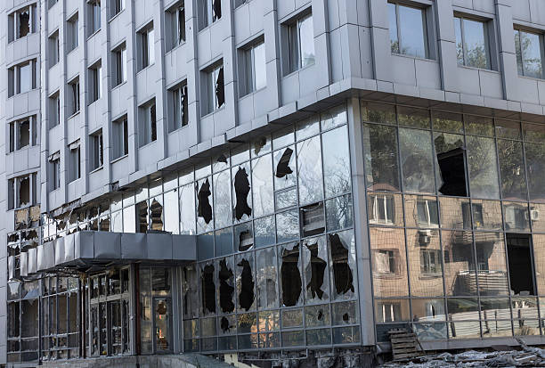 Broken windows of weapons falling into the Donetsk Modern business center of the broken system of multiple rocket launchers, Europe, Ukraine terrorism stock pictures, royalty-free photos & images