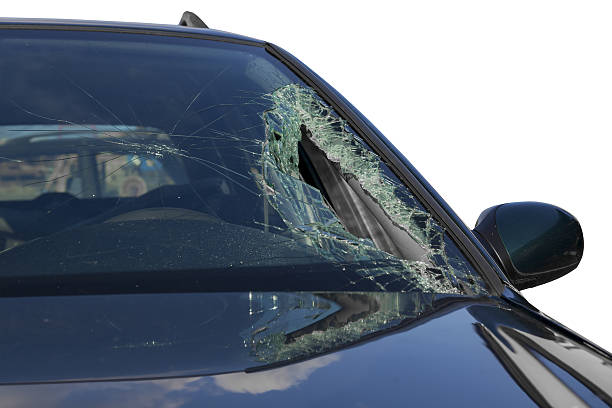 Broken windscreen at black car in traffic accident stock photo