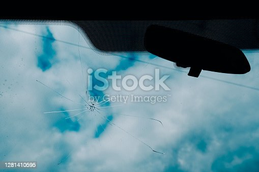 Cracks appear on a car windscreen