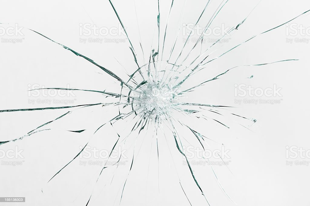 Broken windshield with spidering cracks stock photo