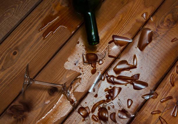 broken wine glass with bottle stock photo