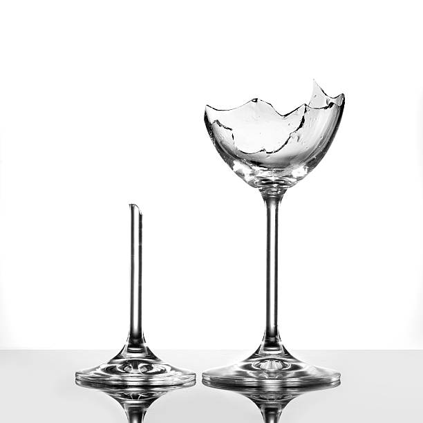Broken wineglasses on white stock photo