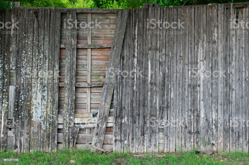 broken wood fence with grass stock photo