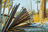 istock A broken wooden fence. A sunny day in the countryside 895930482