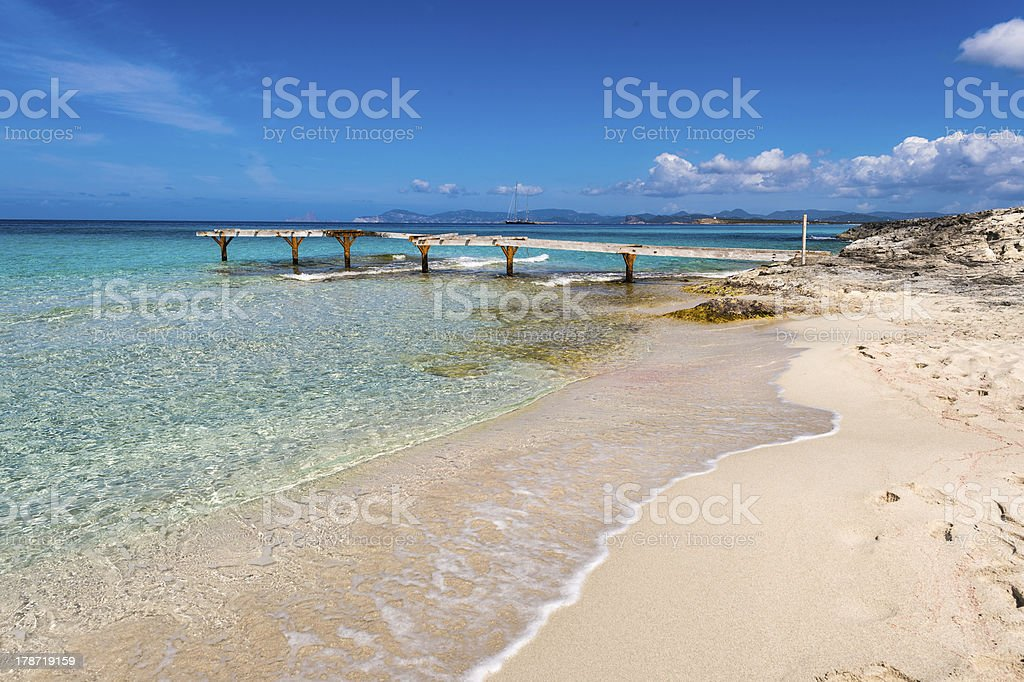 Broken wooden pier Illetes beach Formentera island, Mediterranea stock photo