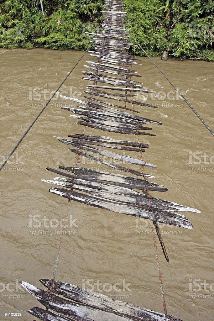 Broken wooden suspension bridge royalty-free stock photo