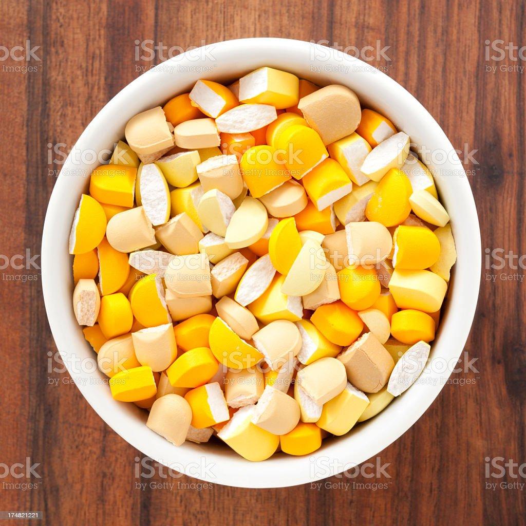 Broken yellow pills royalty-free stock photo