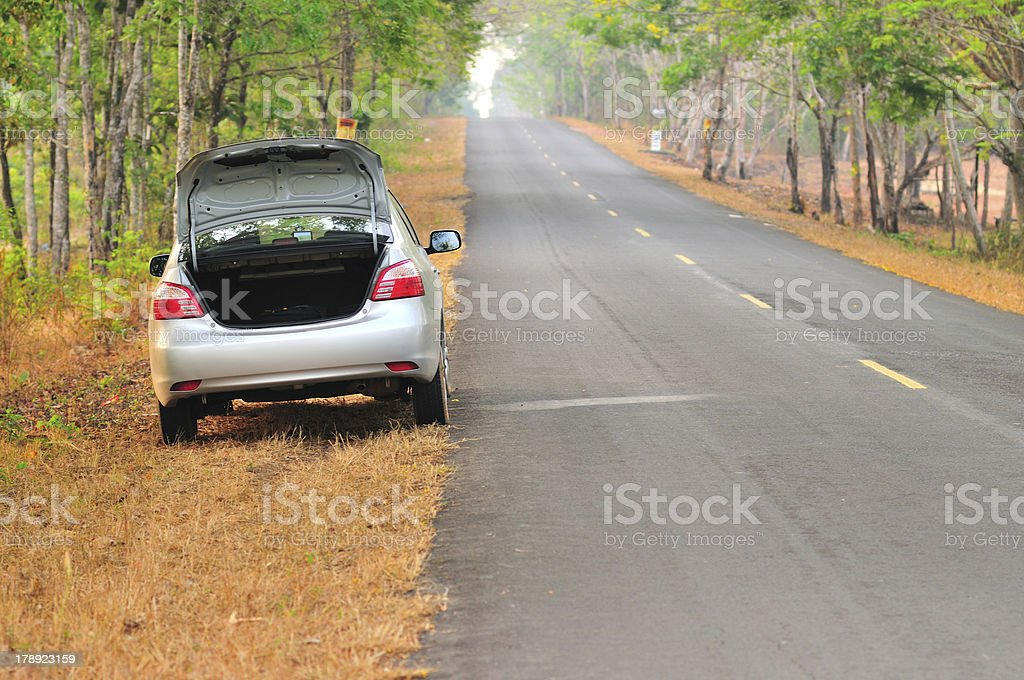 broken-down car on an asphalt road royalty-free stock photo