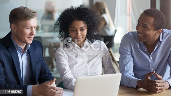 1085713886istockphoto Broker insurer consulting african american clients couple looking at laptop 1146468287