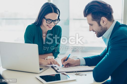 istock Broker showing to the new owner of a house where he has to sign a contract 942979222