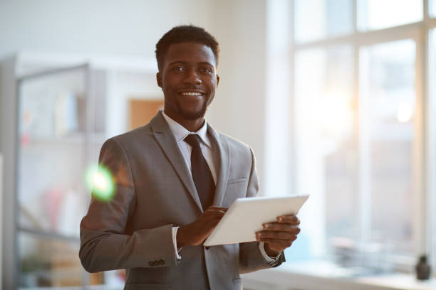 Broker with touchpad stock photo