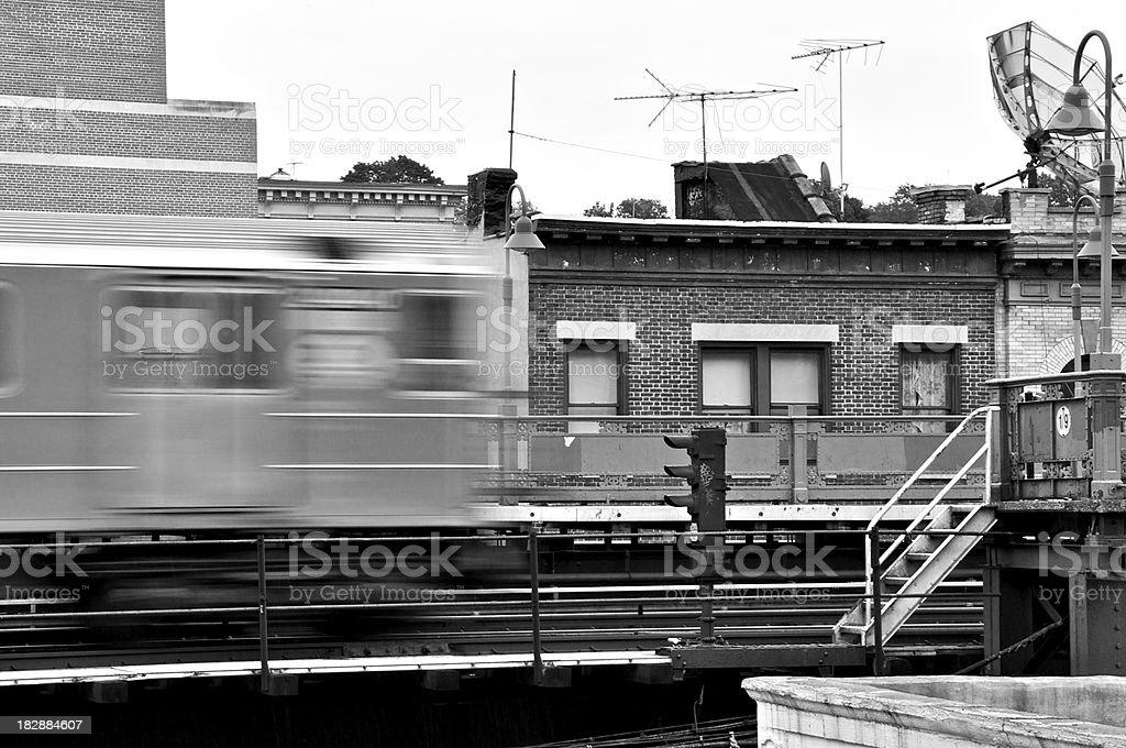NYC B&W - Bronx Elevated Subway train in blurred motion stock photo