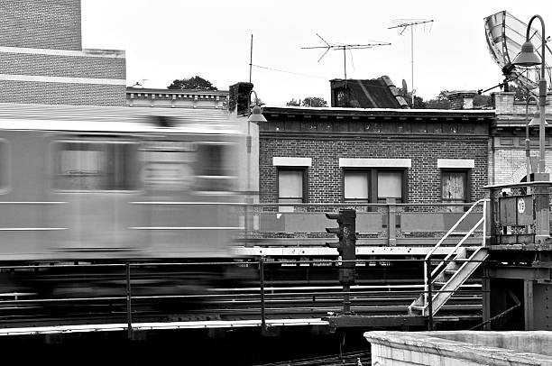 NYC B&W - Bronx Elevated Subway train in blurred motion stock photo