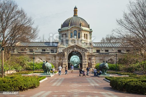 Bronx, New York, USA - April 14, 2014: Landmark Zoo Center Building, formerly Elephant House, at the Bronx Zoo in New York City with visitors present. This world famous zoo opened in 1899.