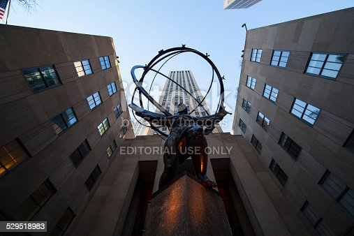 NYC, NY, USA - December 18, 2014: View of the Atlas holding the world on his shoulders. Rockefeller Center soars above him. Midtown Manhattan.