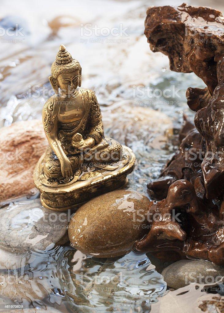 bronze Buddha in water for zen meditation stock photo