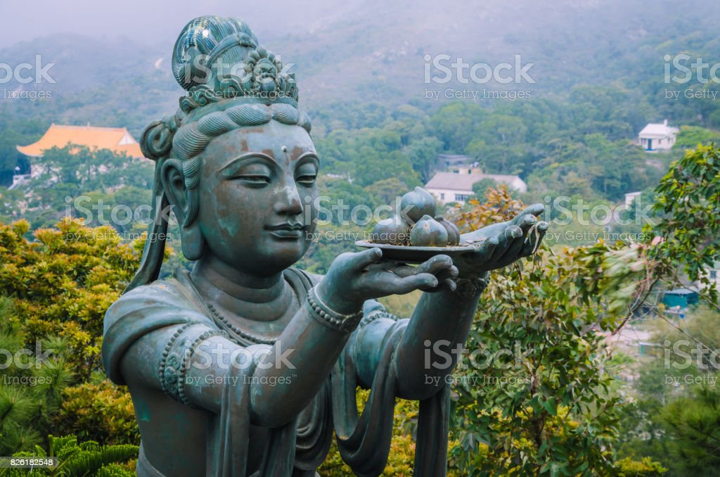 Bronze buddhistic statues praising and making offerings to the Tian Tan Buddha - Big Buddha stock photo