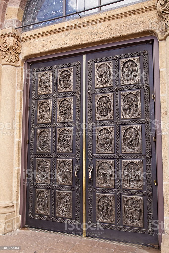 Bronze cathedral doors royalty-free stock photo