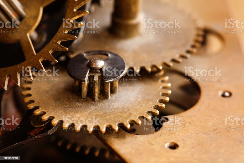 Bronze cog wheels connection machinery construction. Bonding gears mechanic concept. Macro view selective focus photo 免版稅 stock photo