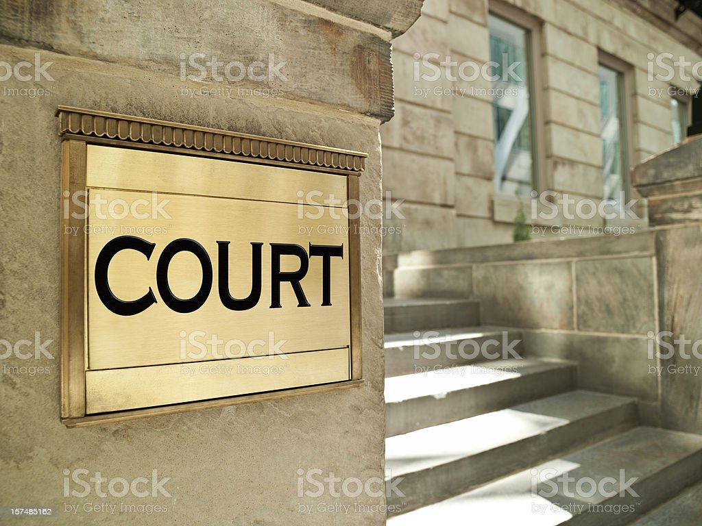 Bronze court plaque on an important building royalty-free stock photo