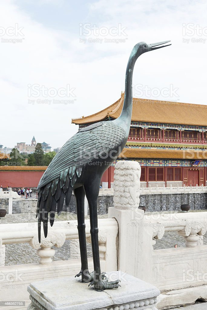 Bronze crane in front of pagoda at Forbidden City royalty-free stock photo