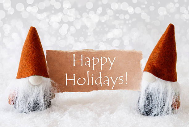 Bronze Gnomes With Card, Text Happy Holidays stock photo