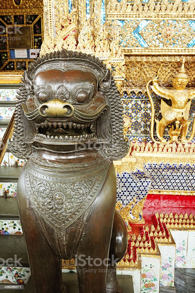 Bronze guardian lion in Temple of the Emerald Buddha stock photo