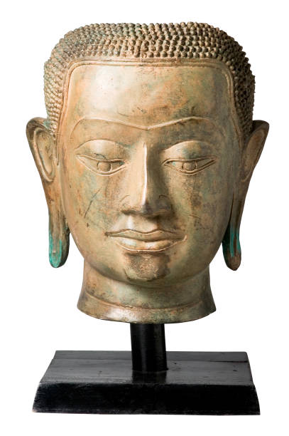 Bronze head of Buddha on stand isolatad on white background. Clipping path. stock photo