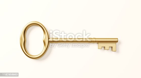 Gold colored bronze key on white background. Horizontal composition with clipping path.
