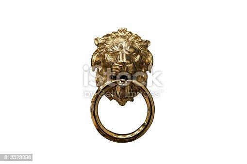 istock Bronze lion door knocker 813523398