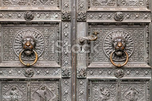 The Gothic Cathedral bronze lion head door knockers in Cologne, Germany