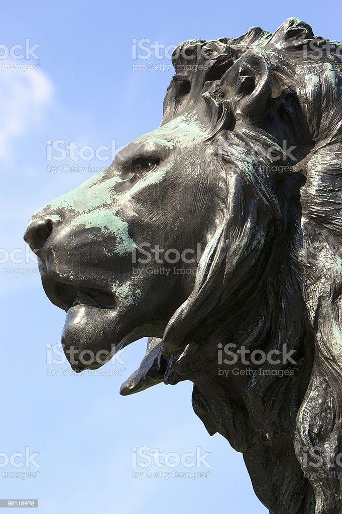 Bronze lion head outside Buckingham Palace royalty-free stock photo