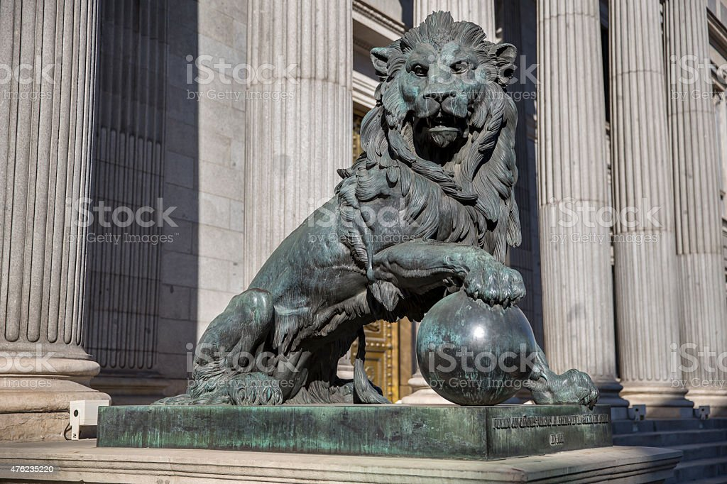 Bronze lion of the Congreso de los diputados. Spanish Parliament stock photo