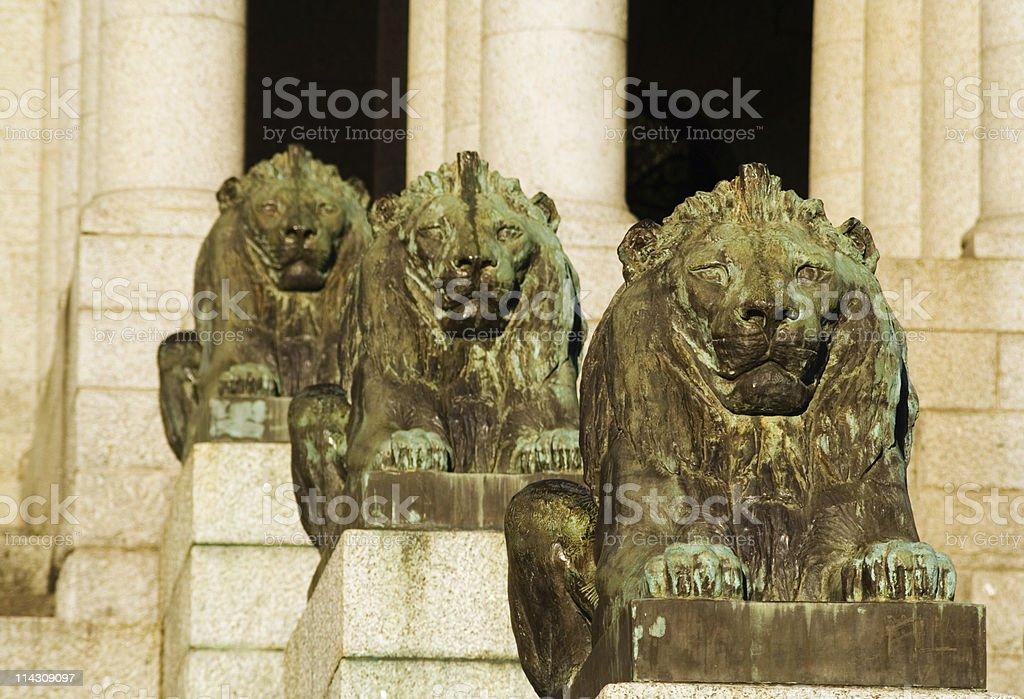 Bronze lions and stone columns stock photo
