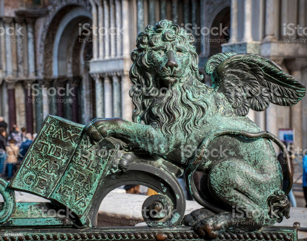 Bronze Lion,Symbol of Venice, outside St Mark's Cathedral. stock photo
