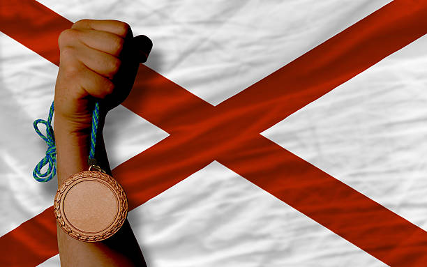 Bronze medal for sport and  flag of alabama stock photo