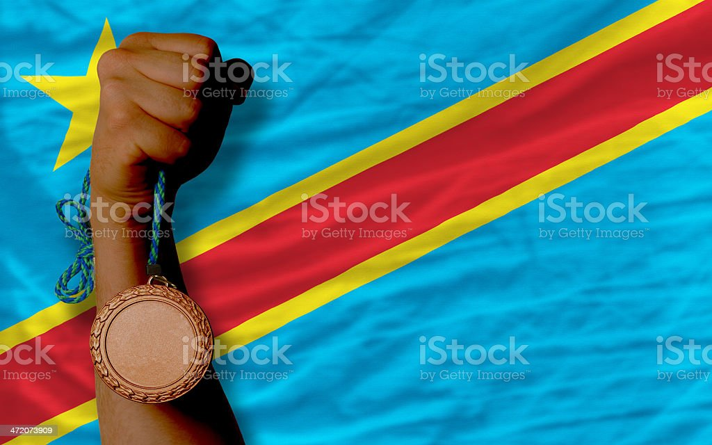 Bronze medal for sport and  national flag of congo stock photo